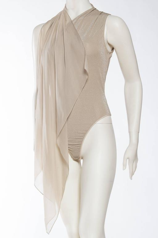 Attached scarf to a one shouldered bodysuit, very clean.