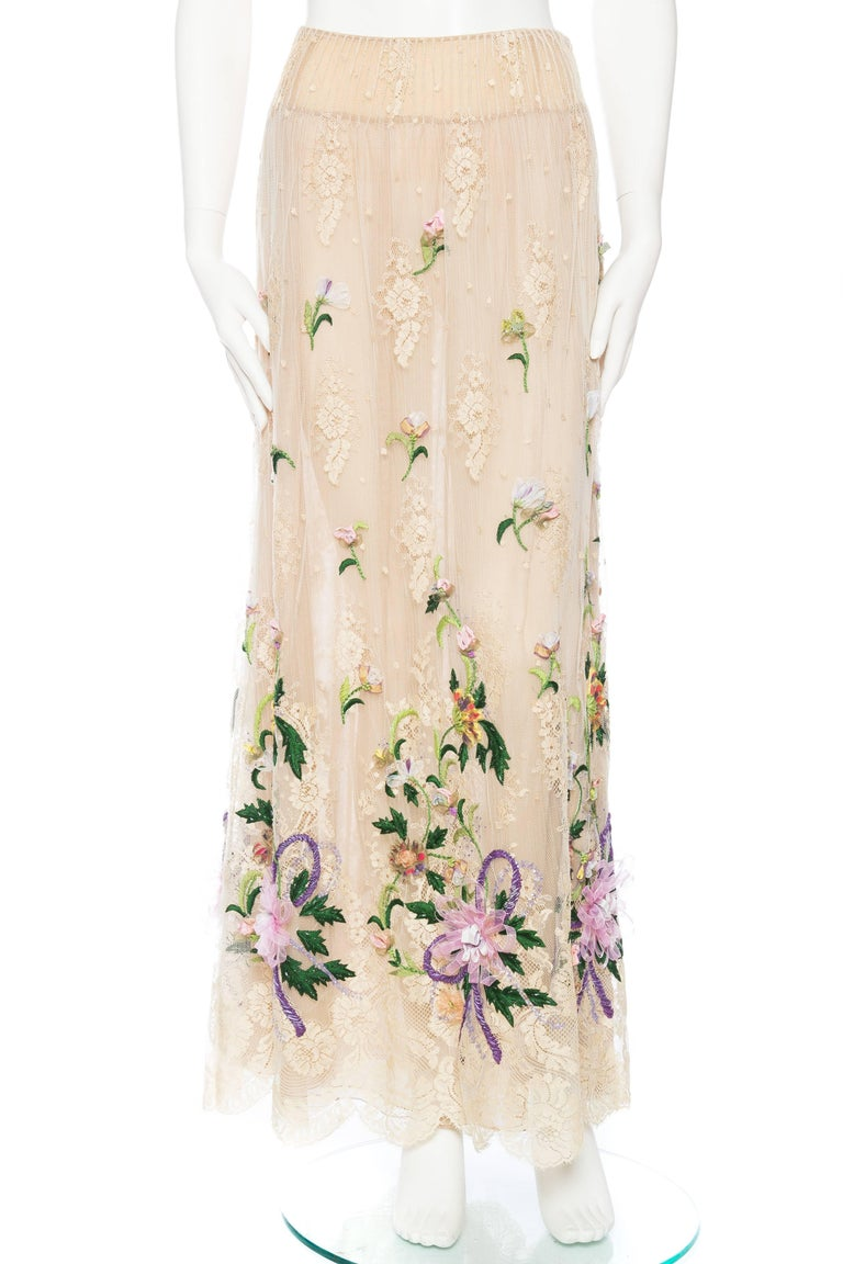 Phenomenal three-dimensional flowers float on air in this beautiful piece from Valentino. The Embroidery is lightly accented with beads as well as hand painted highlights, a beautiful truly hand crafted piece in a great larger size. Please note this