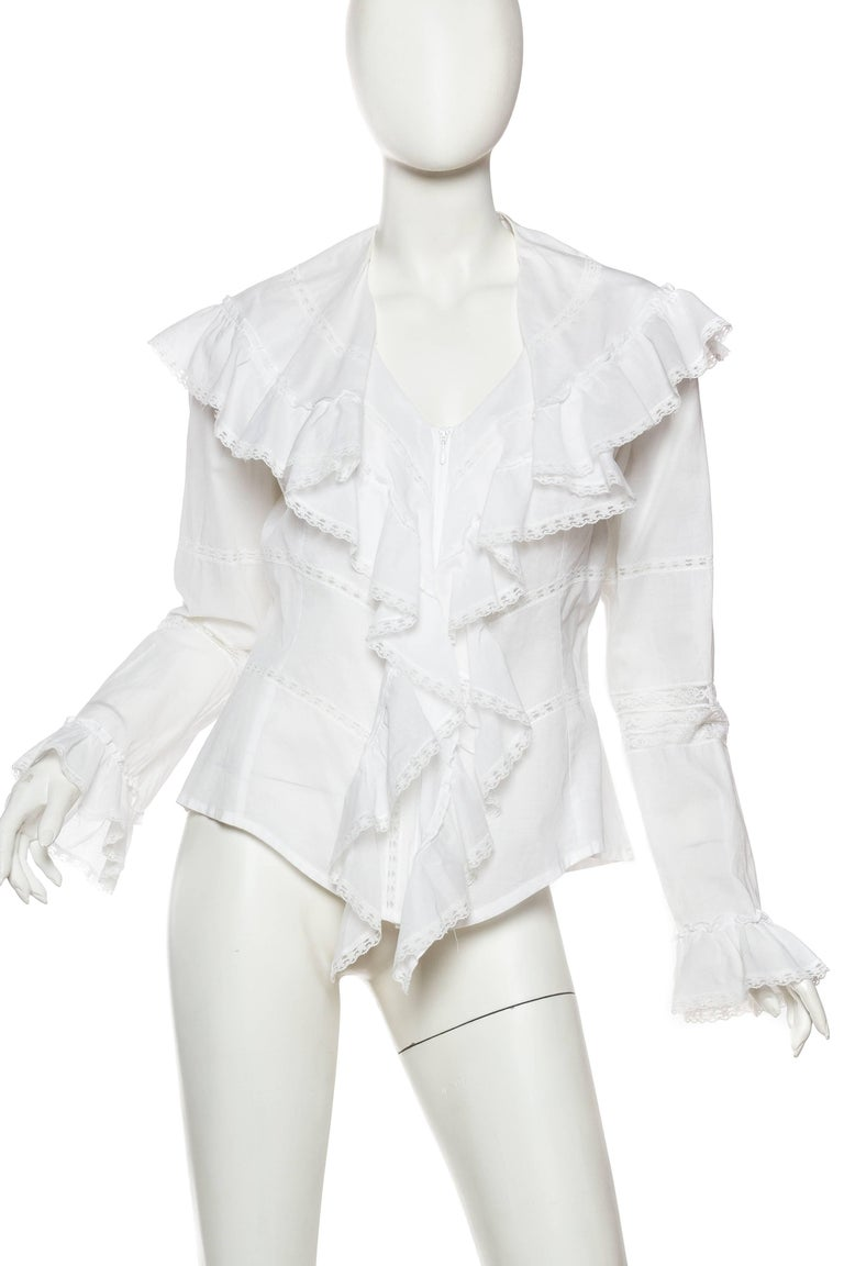 Beautifully styled off of Victorian lines this blouse is modern and timeless. The Cotton and Lace blouse dates to the 1970s or 1980s, although it could very well have been picked up at Barney's yesterday. Timeless French Fashion and it's best.