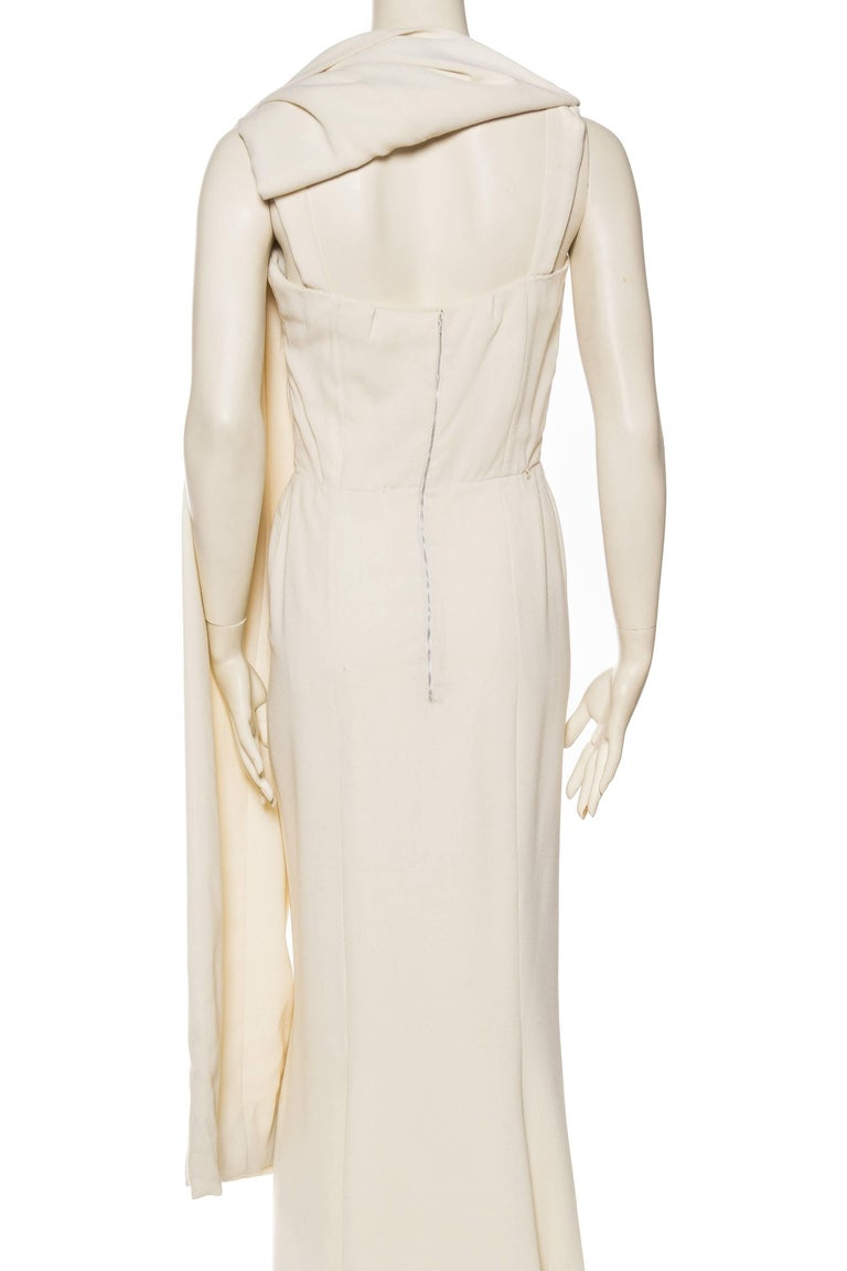 024ca936 1960s Modernist White Pierre Balmain Gown with Cape For Sale at 1stdibs