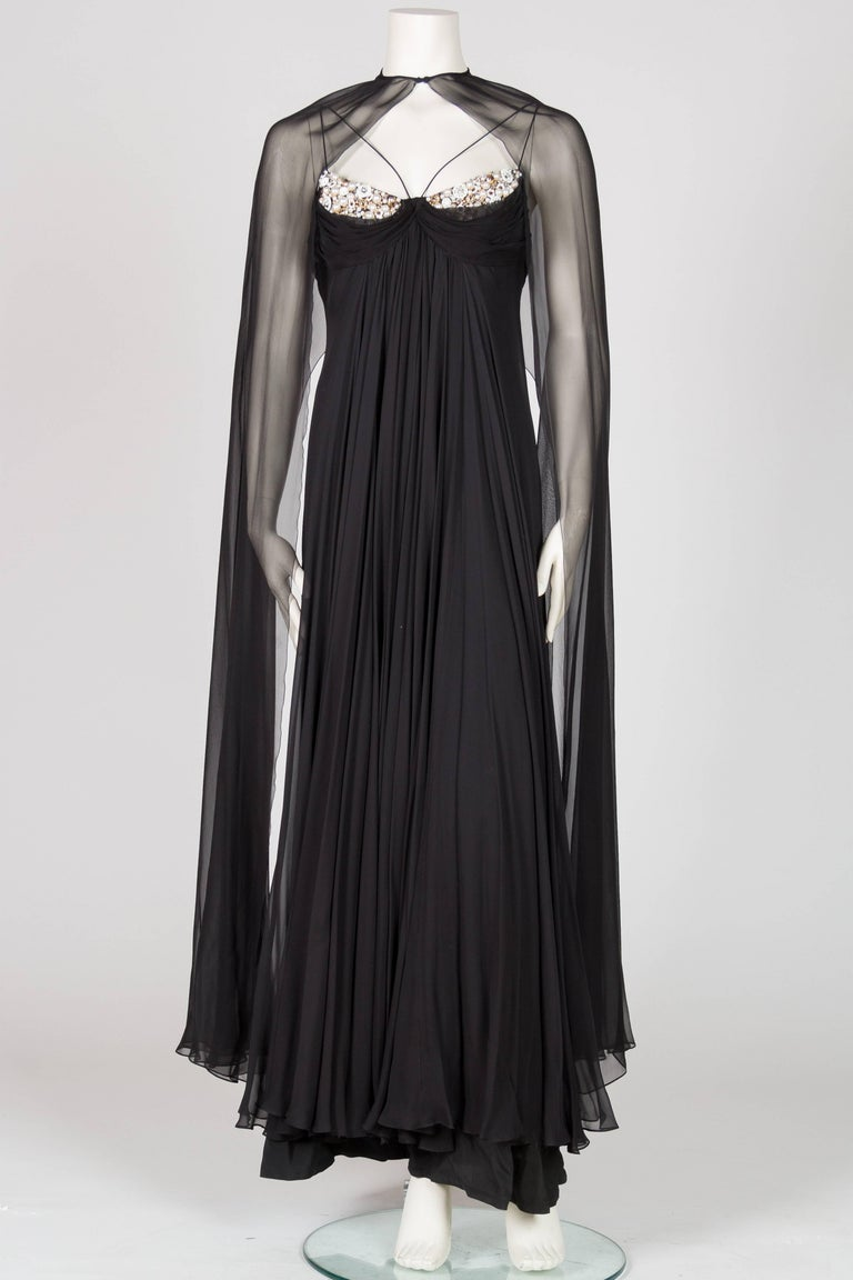 Empire waist with zipper up back, fits small to medium bust. Accented with pearls, beads and crystals. Lined in silk. Listing as 1970s however this gown could be from the late 1960s. Valentino introduced this cut in 1966 and these style gowns are
