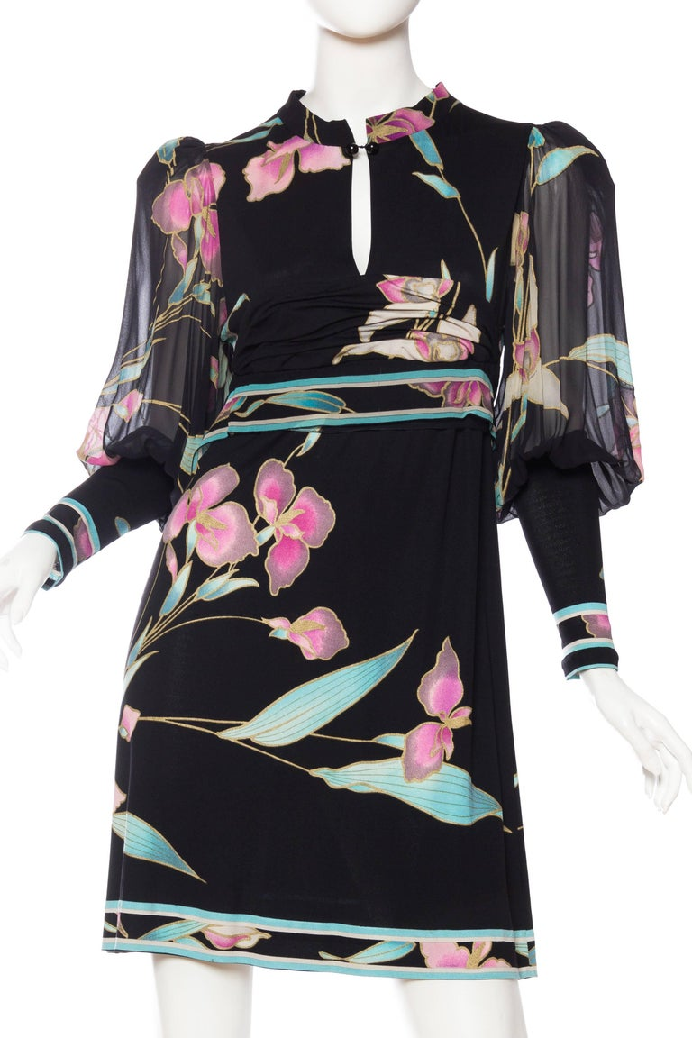 Silk jersey dress with chiffon sleeves.