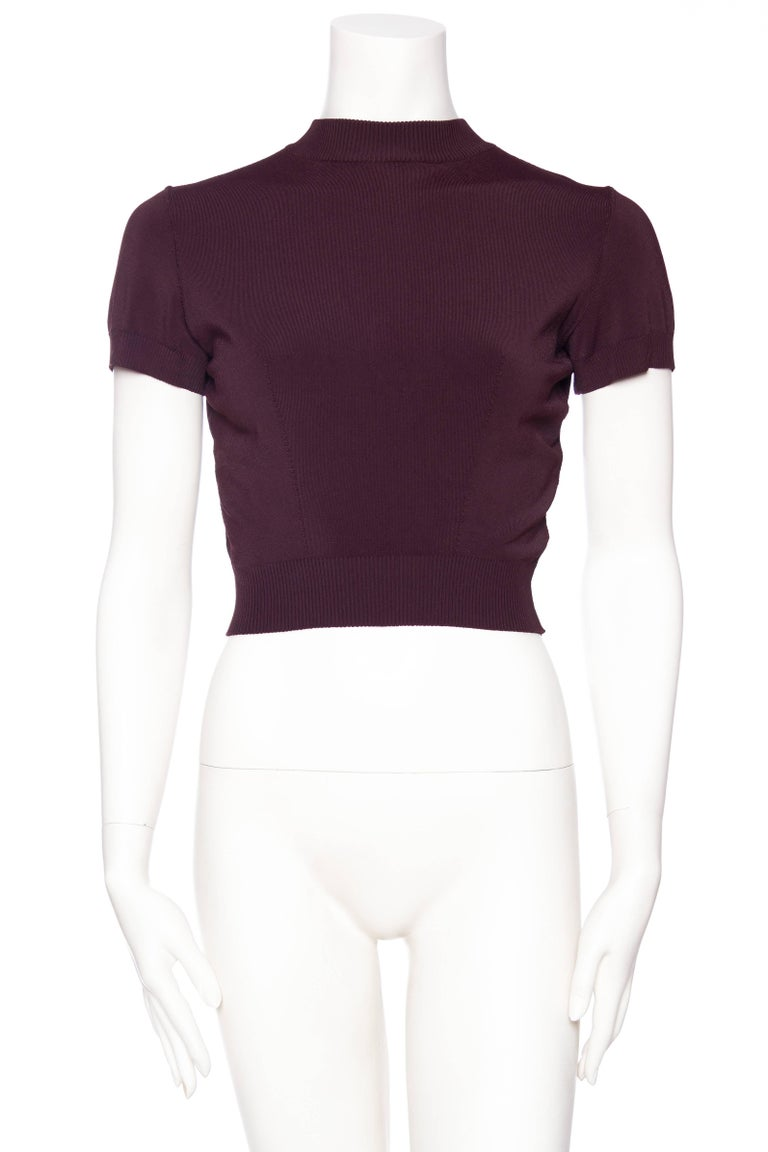 Cropped just so, in the most luscious deep aubergine. Great with hi-rise jeans or pants