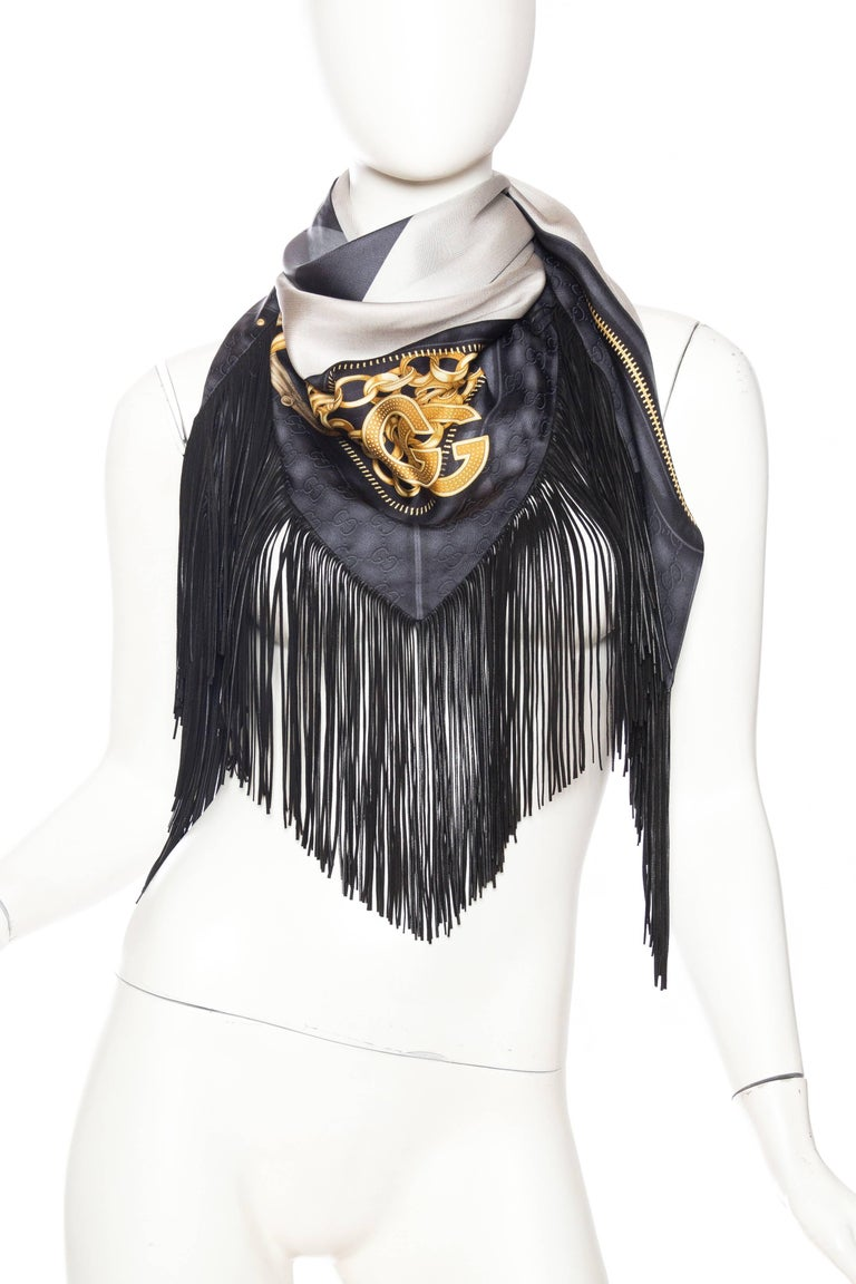 Double layers of silk with a leather fringe gives this scarf a great feel and drape, a luxurious feeling piece when worn. Comes with original box.
