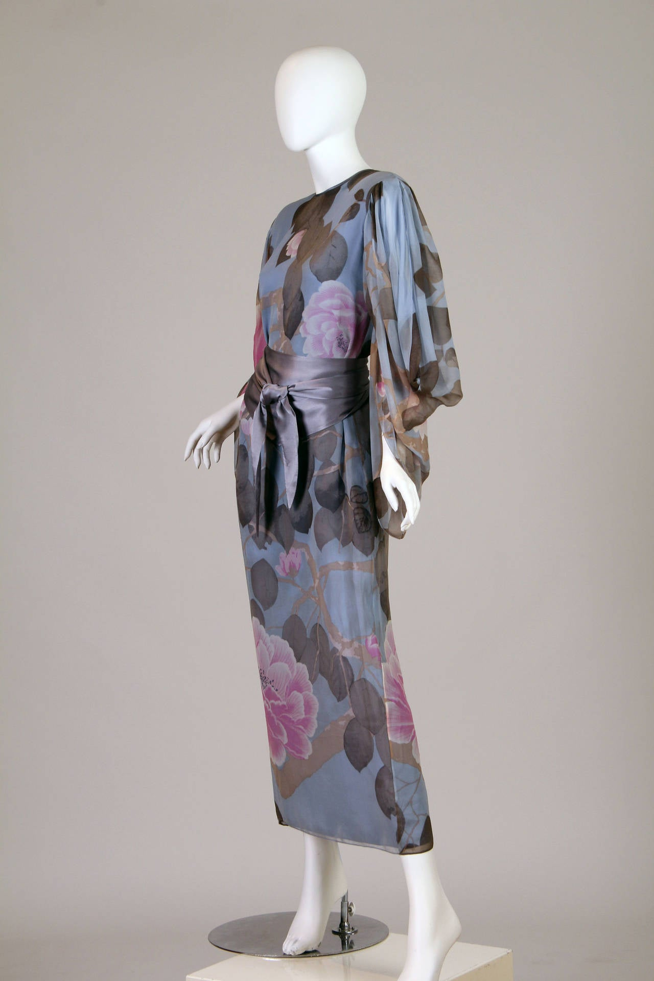 This beautiful silk vintage floral print dress is a quality garment by Hanae Mori. Mori opened her fashion house in 1951 and steadily became more and more popular with these gloriously feminine, light and airy dresses until she became the first