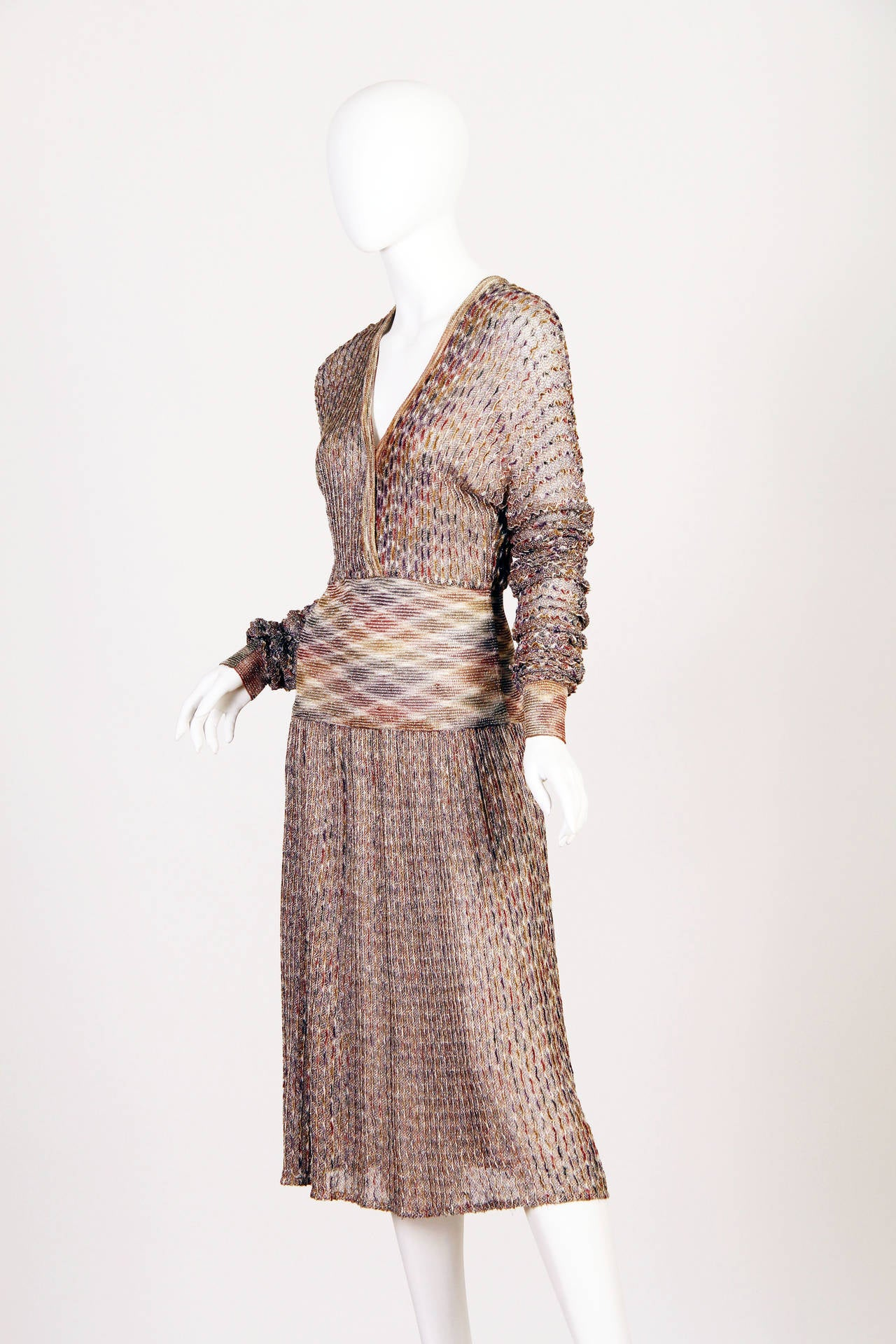 Beautiful and semi sheer orange label 1970s Missoni in browns and gold lurex. The entire dress has a sparkle to it from the lurex, however the design of the dress with sleeves allows this piece to be worn day and night.