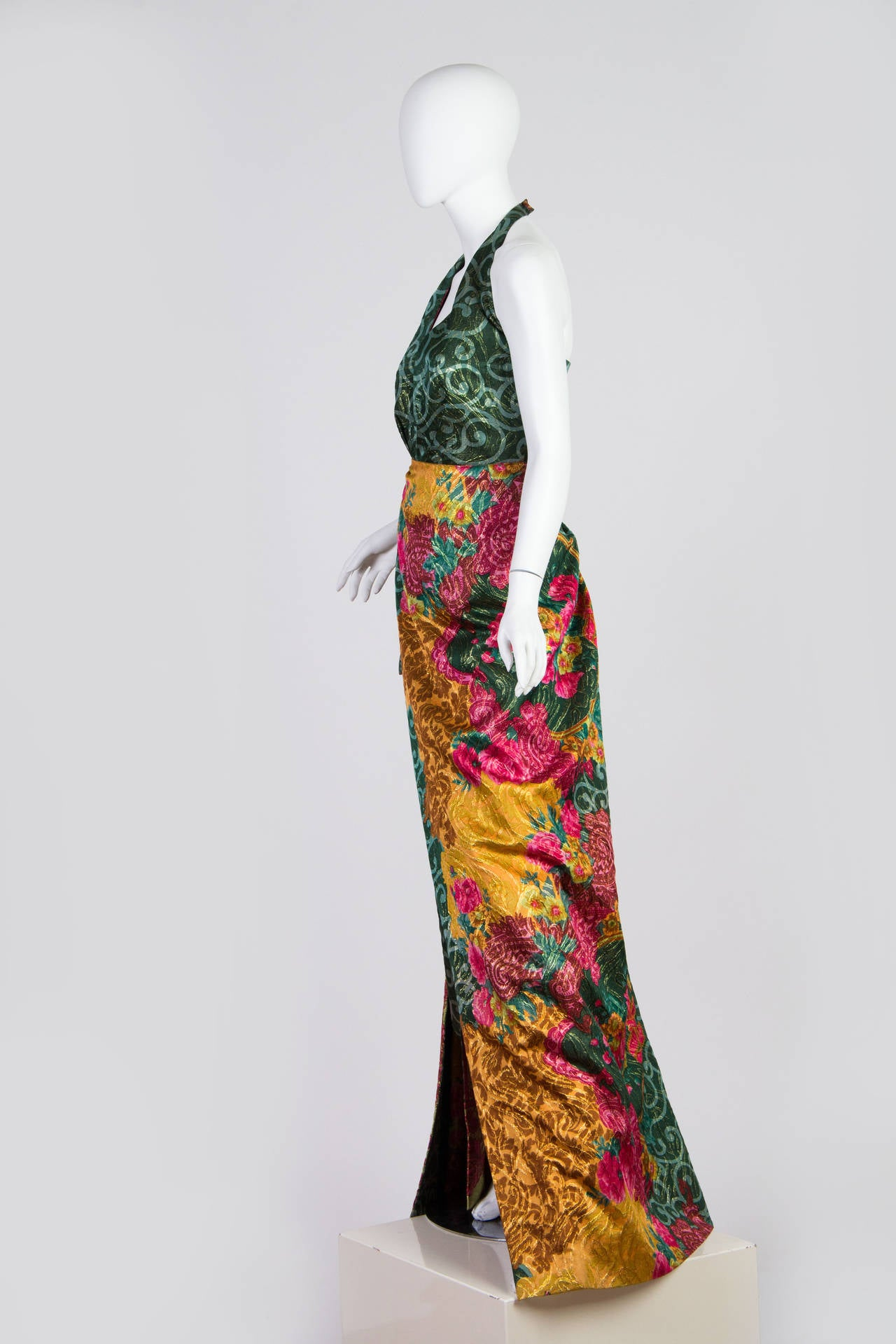 Known for their use of the finest Milanese textiles for over three generations the Curiel ladies do not disappoint with this gown. Because their work is so expensive and not mass produced it is very hard to find information on the history of the