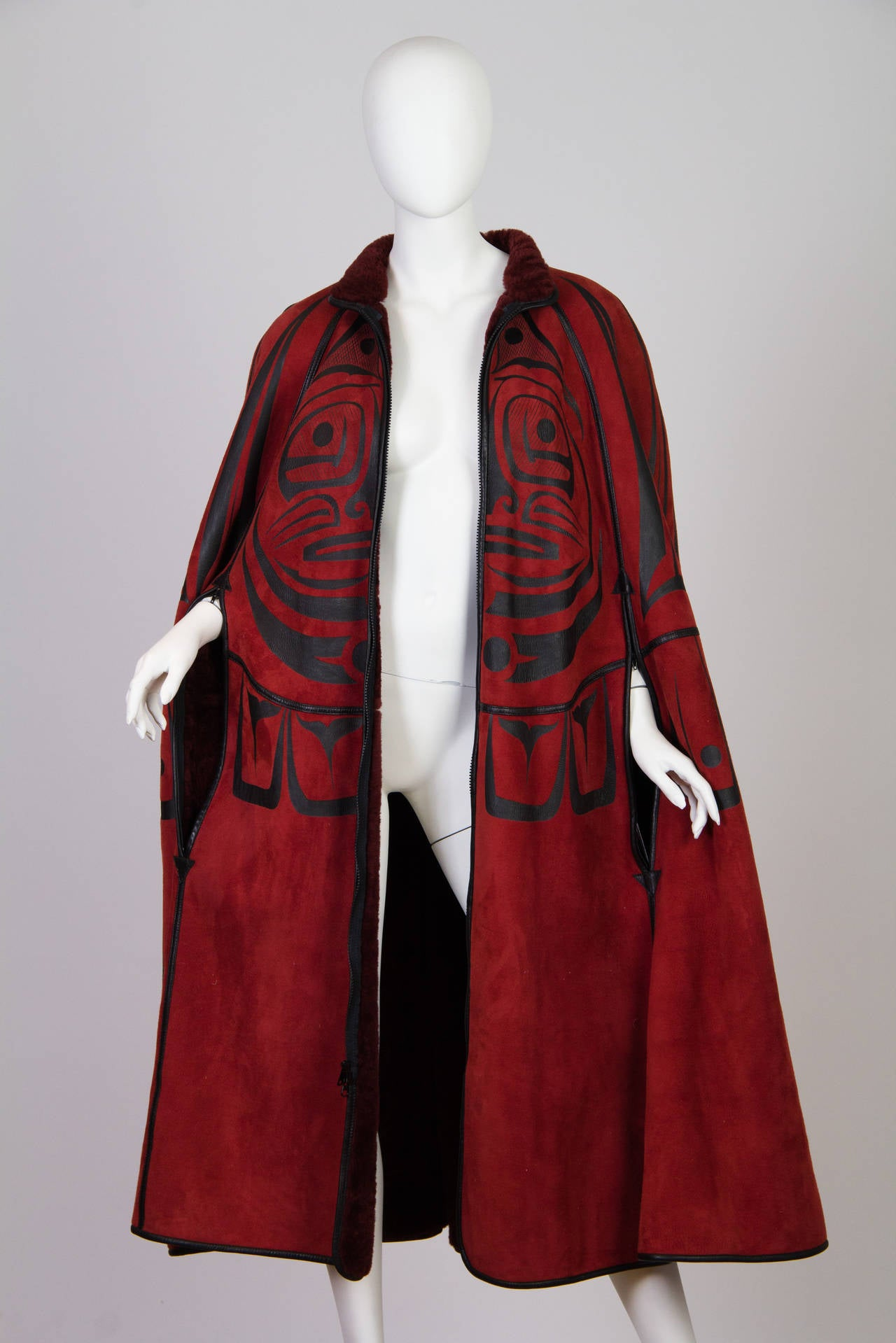Phenomenal and epic design to this very unique piece. The cape zippers up the center front and there are two slits at the sides for the hands. The suede side of the cape as well as the fur is in pretty much mint unworn condition. There is no label