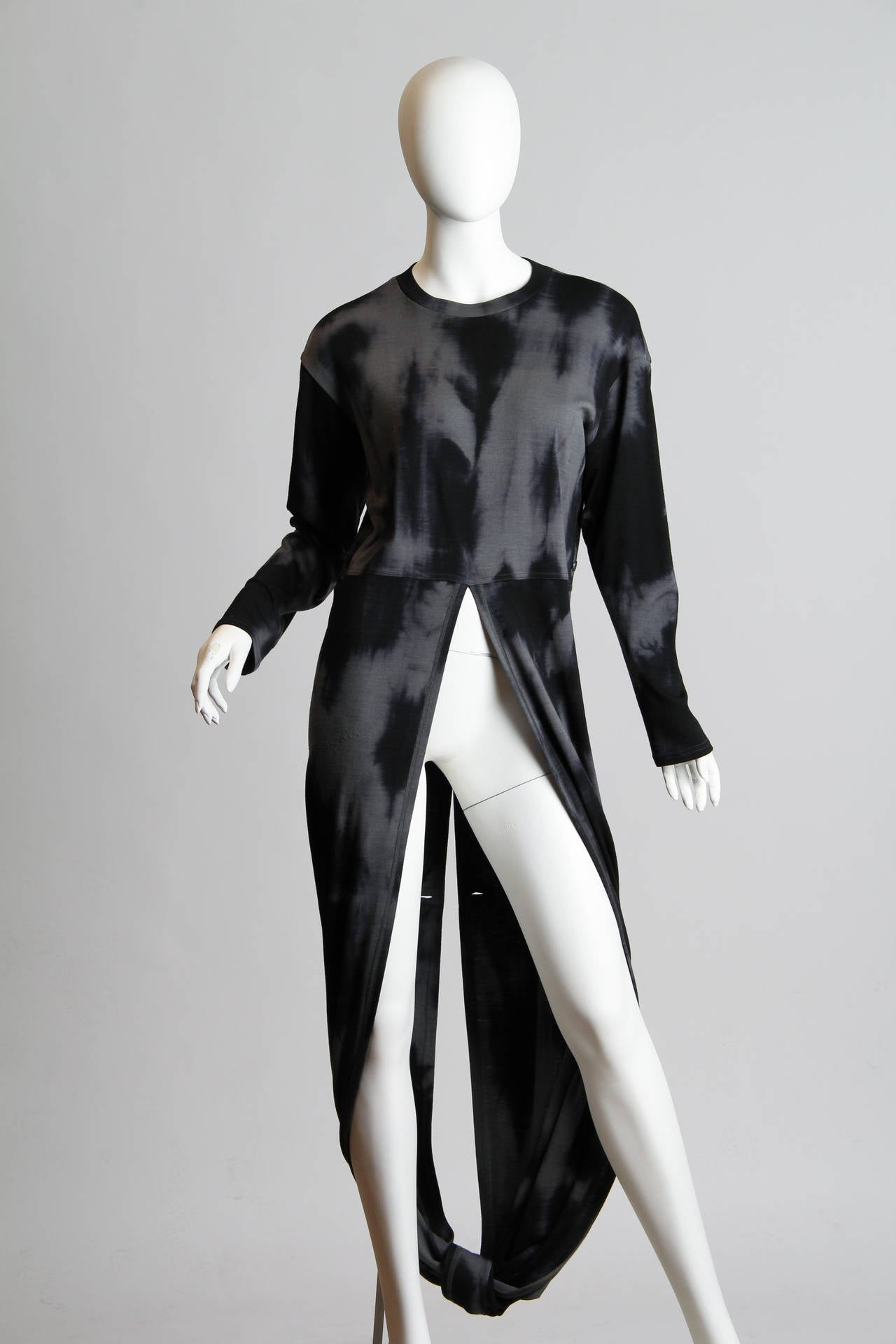 This striking garment by famed avant-garde designer Issey Miyake is a play on the 19th century tailcoat, updated for our modern times and changing world. The re-imagined garment evokes how much the world of fashion has changed since the age of men