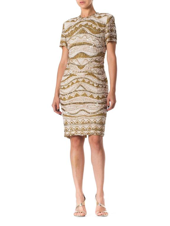 This dress is a well designed version of the classic 80s excess bent for dressing for evening. Gold and black is common however gold and white is an entirely different glamazon.