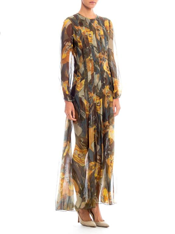 We believe this beautiful dress from Pauline Trigere has had the lining removed and may have been altered. Regardless it is a gorgeous dress in an abstracted floral print rendered in earth tones. The dress is cut wide but then has been pleated down