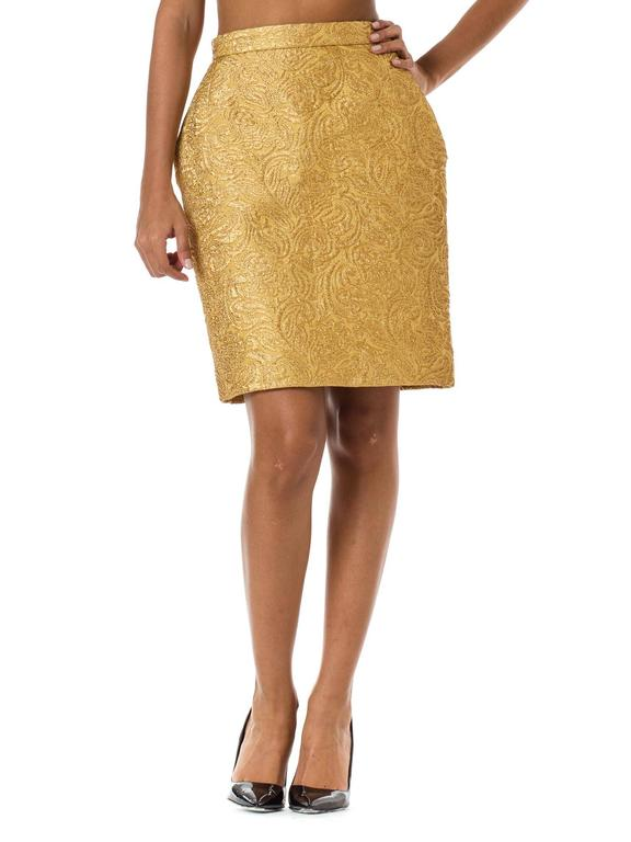 Gorgeous gold arabesques and flowers dance about the rich reptile of this skirt from Yves Saint Laurent. Fully lined and pencil cut with pockets.
