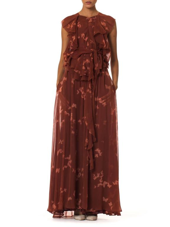 This is a gorgeous blouse and skirt set by Holly's Harp, printed all over with the white silhouettes of butterflies. Made of an earthy red chiffon, both garments are constructed of several layers of the fluttering sheer to allow light and air to