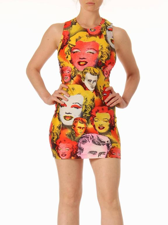 There are many iconic designs in the history of fashion, however there are not that many iconic prints. Second only to Schiaparelli's lobster dress does one print stick in the fashion psyche as the Marilyn James Dean Warhol print by Gianni Versace.