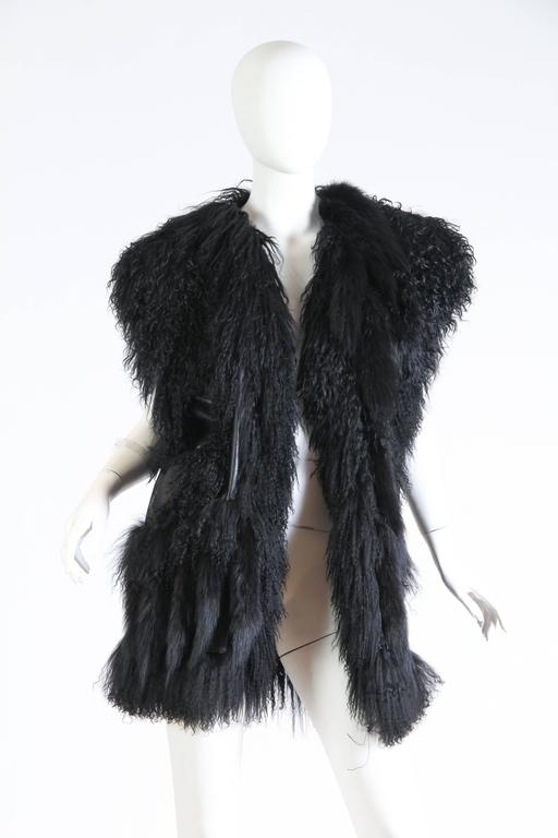 Asymmetrical pieces of mongolian lamb and leather have been artfully pieced together creating a luxurious patchwork. The leather and fur are in top buttery soft condition and this piece appears to have not been worn.