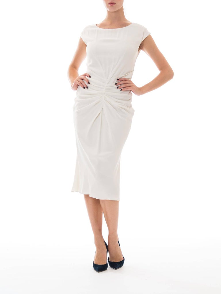 This classically designed and ultimately flattering dress fits flawlessly.