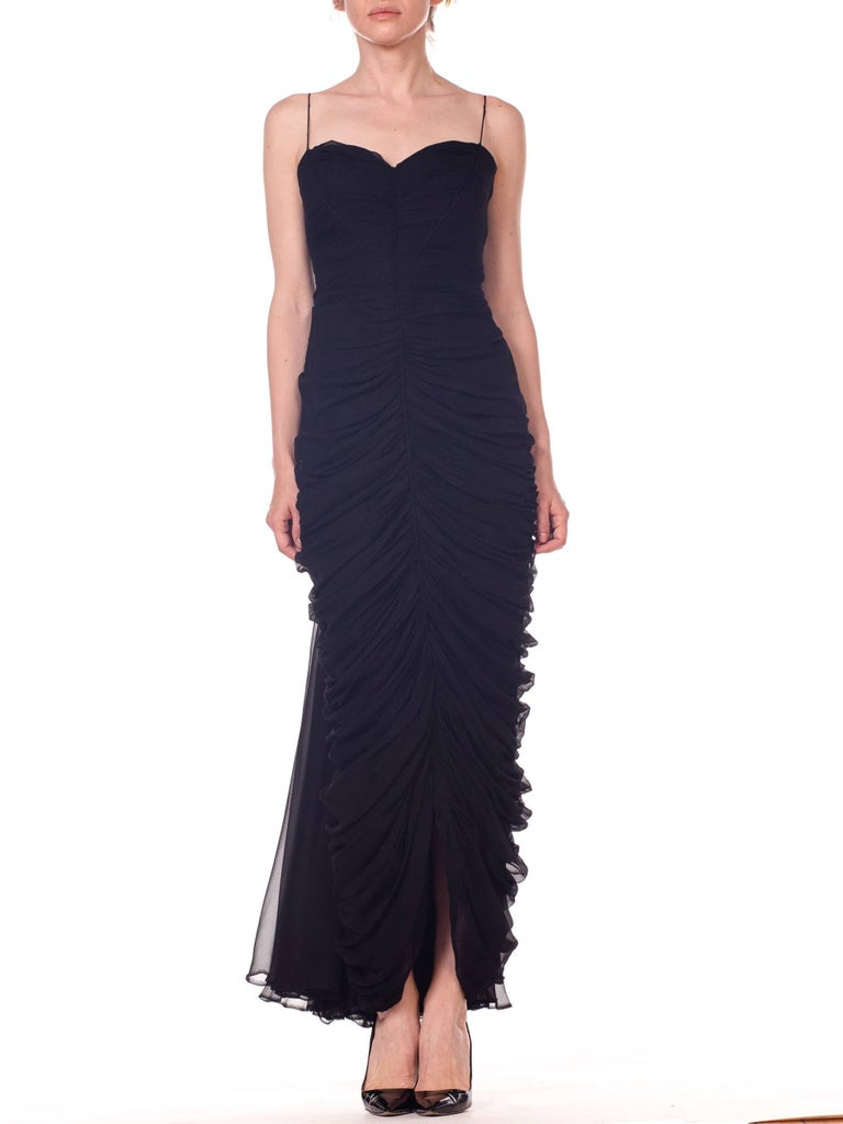 From the estate of a rat-pack era Vegas lounge singer, a fantastic boned understructure for a woman with great curves, it is too loose on the hips and bust of our model and would fit a size 6 with a nipped waist better.