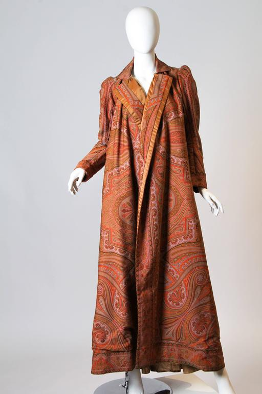 "This is an incredible coat or ""wrapper"" from approximately 1897-1903, the final years of the Victorian era. Wrappers were popular from the 1850s on as a gown which might be worn while working at home or receiving friends for tea. Wrappers were often"
