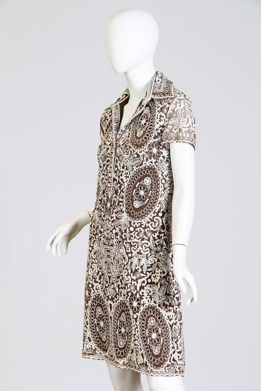 Elegant transitional dress in embroidered chiffon from esteemed designer Naeem Khan. Great wearable size and elegant styling.