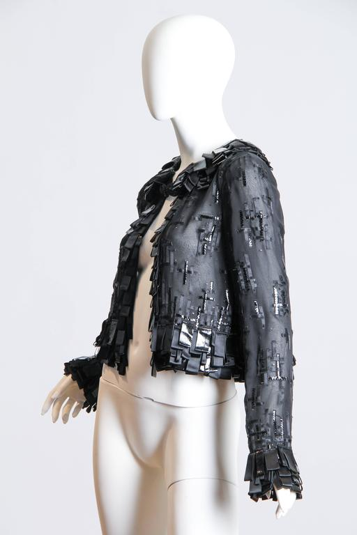Gorgeous phenomenal handworked jacket. Made from silk chiffon Mr De LaRenta has artfully embellished this jacket with ribbons of satin and patent leather in a modernist design recalling the work of Harry Bertoia.  Like a Bertoia wall sculpture the