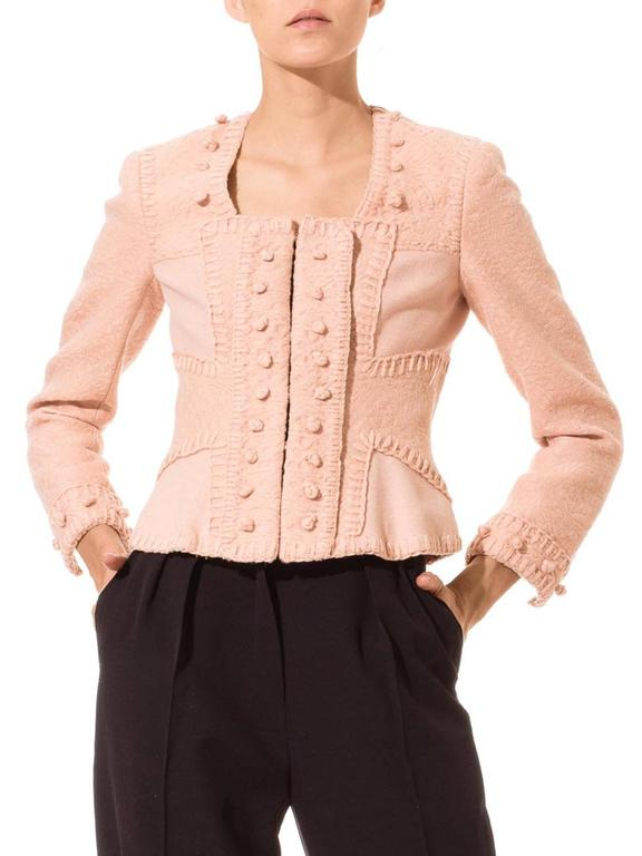 This is a wonderful jacket from Yves Saint Laurent. Made of a beautiful pink cloth with an intricate woven-in pattern, the jacket's attention to detail is flawless. The charming vintage style sports a cropped high-hip hem with gusset insets for a