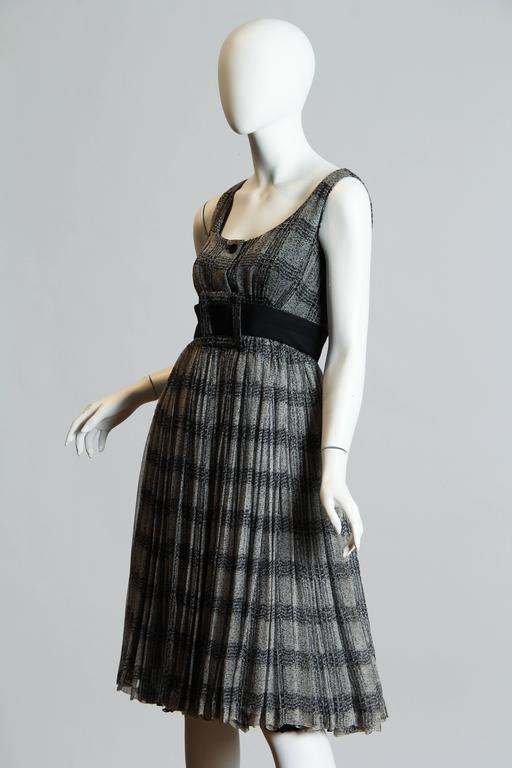 This is a wonderful printed plaid dress from designer James Galanos. Galanos was one of the most respected and well-loved couturers in North America and counted a wide selection of Hollywood and the social elite amongst his loyal customers. This