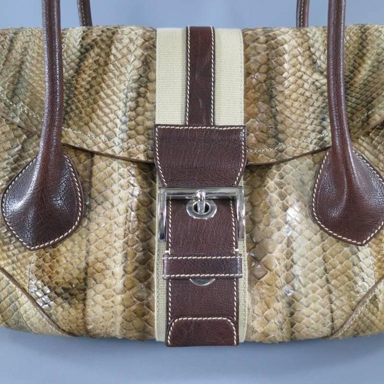6ef826f526f9 This rare shoulder bag by PRADA comes in a gorgeous tan python skin leather  and features