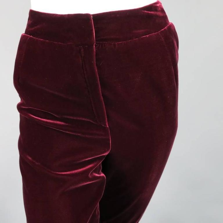 These gorgeous high rise dress pants by OSCAR DE LA RENTA comes in a luscious deep burgundy velvet and feature a thick waist band, zip fly, and tapered leg. Made in The USA.   Excellent Pre-Owned Condition.Marked: 6   Measurements:   Waist: