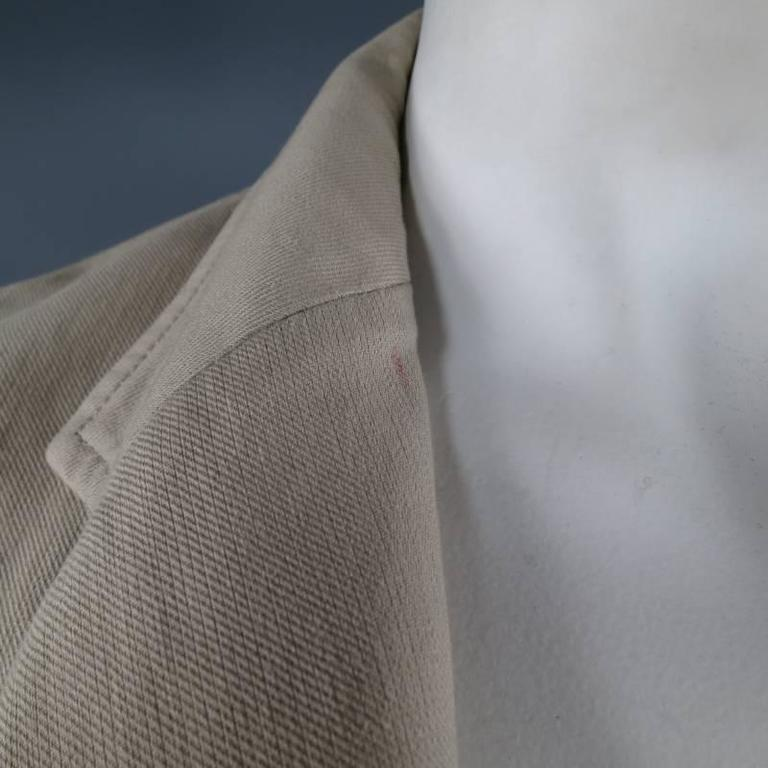 Y's by Yohji Yamamoto cotton sports jacket features long lapels, single button closure, two flap pockets and brand specific tailoring at the waist in Khaki, Made in Japan.   Excellent Pre-Owned ConditionMarked: 3   Measurements:   Shoulder: 18