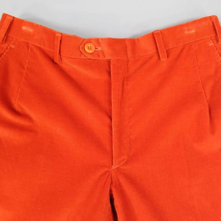 These classic BRIONI pants come in orange thick ribbed corduroy with frontal darts and a cuffed hem. Made in Italy.  Retail: $700   Good Pre-Owned Condition. Marked: 32   Measurements:   Waist: 32 in. Rise: 10 in. Length: 30 in.  Item ID: 49303