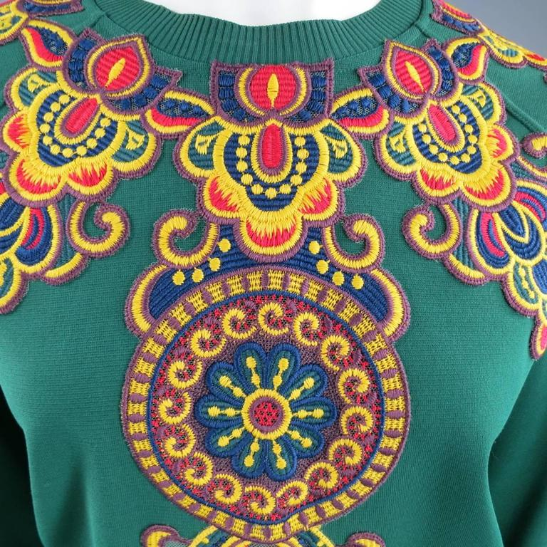 This fabulous VALENTINO pullover comes in a structured viscose blend and features a crew neck, and beautiful, multicolored embroidery details. Made in Italy.