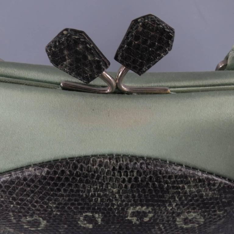 This cute mini PRADA retro inspired purse comes in a gorgeous mint green satin with mating lizard leather body, satin piping, enamel plaque, and kiss lock closure. In great condition with minor discoloration. Includes dust bag and authentication
