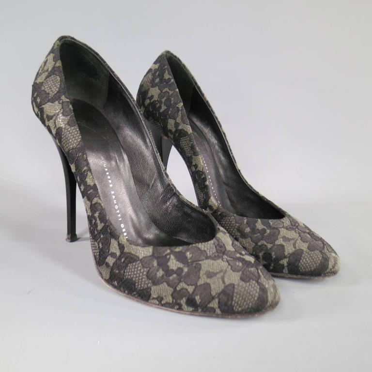 These sexy GIUSEPPE ZANOTTI pumps come in charcoal grey with black lace overlay with a high matte lacquered stiletto heel. Made in Italy.