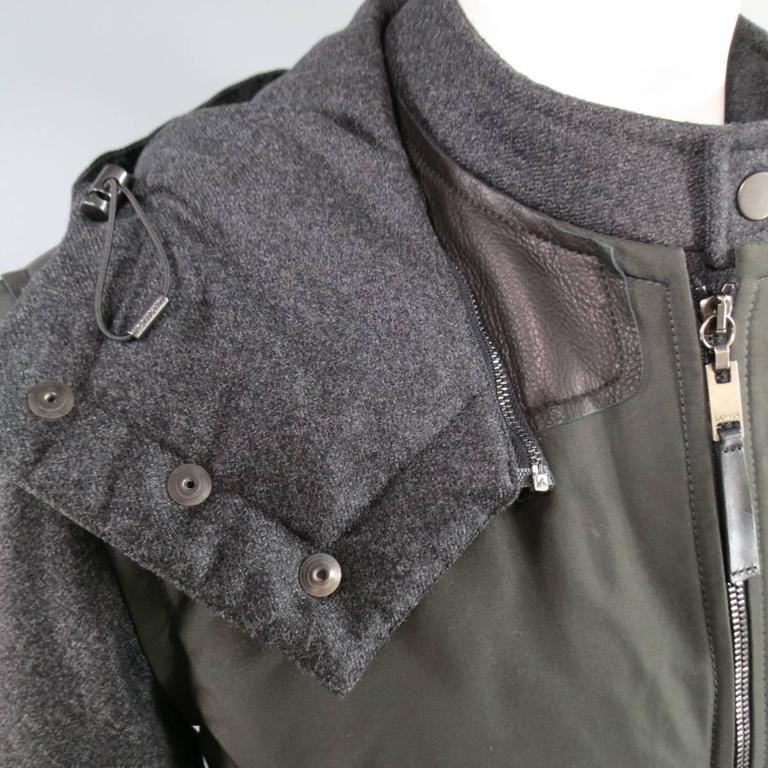 LANVIN Jacket consists of wool blend material in a olive color tone. Designed with a zipper front, double layer lining in charcoal that includes button closures. Multi-zipper pocket front with side pockets featuring snaps. Tone-on-tone stitching,