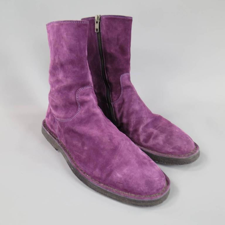 ANN DEMEULEMEESTER Boots consists of suede material in a purple color tone. Designed in a round-toe front, high ankle collar, tone-on-tone stitching along vamp and collar. Detailed with a side-zipper opening and leather lining. Crepe sole.   Good