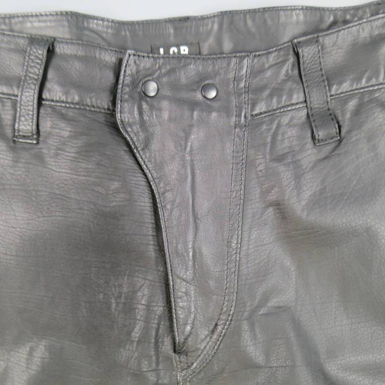 These cropped drop crotch pants by L.G.B. come in soft, light weight black leather with a snap closure front, suede under panel, snap pockets, side tabs, and ribbed band hem. Made in Japan.   Good Pre-Owned Condition. Marked: 2