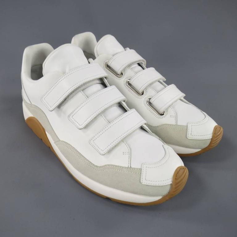 best website 0acc9 9c570 Brand New DIOR HOMME Sneakers consists of leather material in a white color  tone. Designed