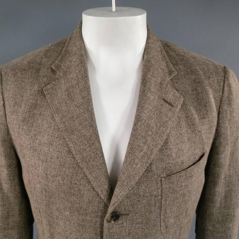 LORO PIANA Sport Coat consists of a linen/ cotton blend material  in a brown color tone. Designed with a notch lapel collar, 3-button front and bottom patch pockets. Detailed with a top patch pocket, 4-button cuff and double back vent. Heather