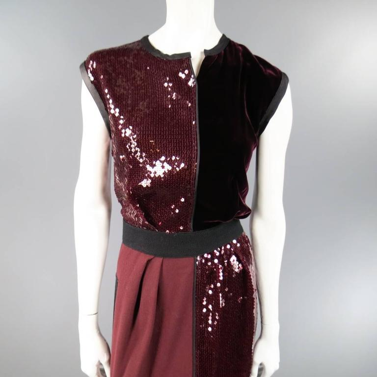 This fabulous MARC JACOBS cocktail dress features patchwork panels of burgundy sequin, velvet, and crepe with black leather trim, woven belt panel, and slit neckline. Made in USA.
