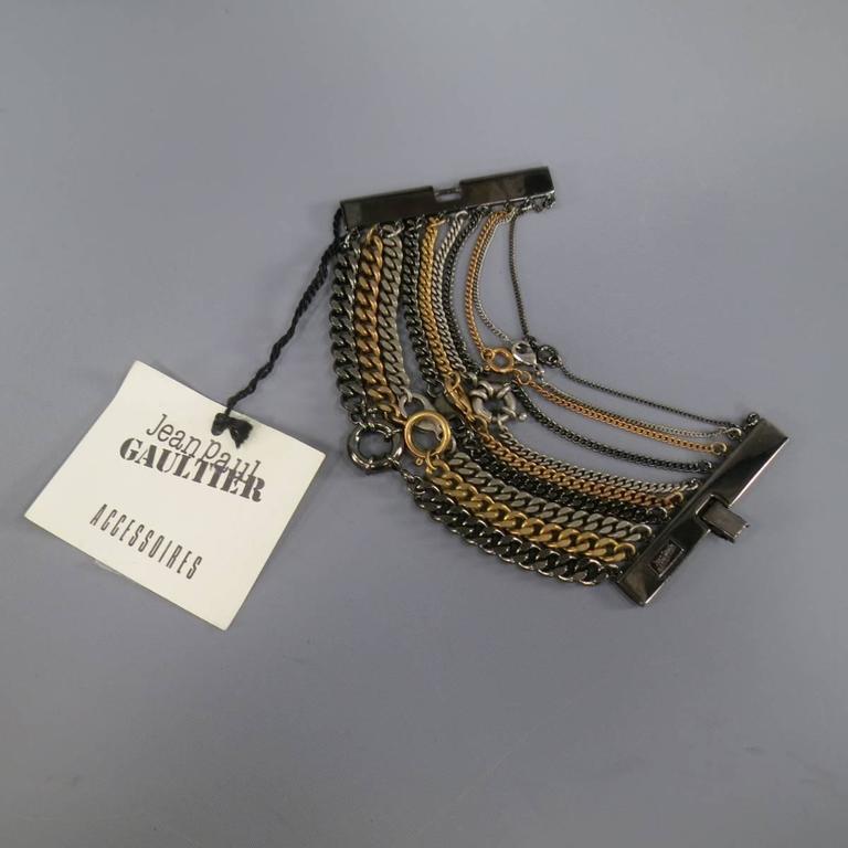 JEAN PAUL GAULTIER Silver Gold & Gunmetal Multi Chain Cuff Bracelet In As new Condition For Sale In San Francisco, CA