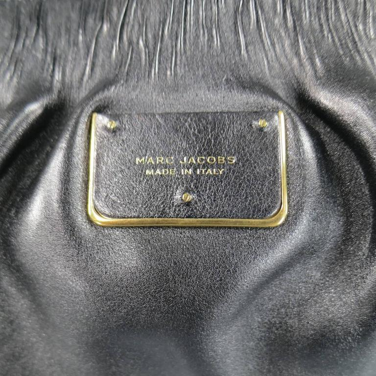 Lovely MARC JACOBS shoulder bag in black gathered leather featuring a gold tone double zip closure, pleated top, textured base, front plaque, and double woven chain top handles. Hardware protector stickers still attached. Made in Italy.   New