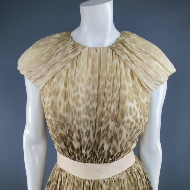 This stunning Giambattista Valli Couture cocktail dress comes in a beige and brown gradient ombre leopard cheetah stretch silk chiffon and features a gathered bodice, gathered shoulder panels, peachy beige ribbon waistband, and soft pleated A line