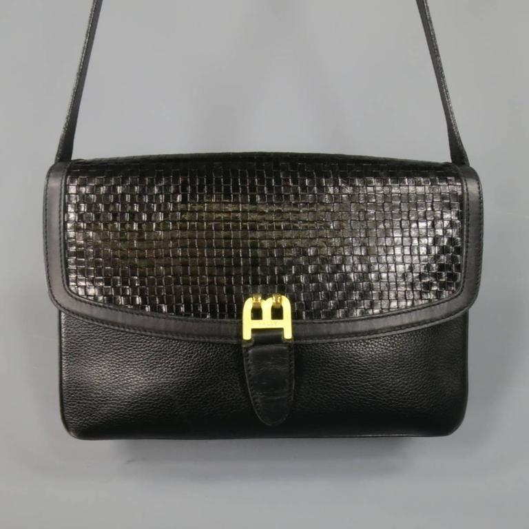 This Rare Vintage Bally Handbag Comes In Black Pebbled Leather And Features A Woven Flap