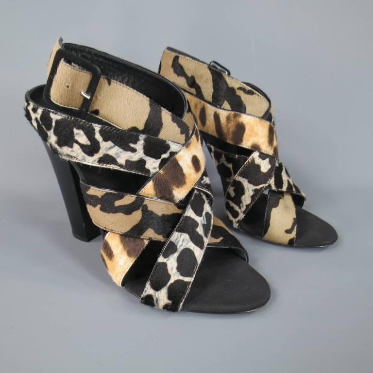 "These fabulous GIUSEPPE ZANOTTI ""Alien"" sandals feature a chunky matte black heel, open toe, and woven straps of beige, taupe, and cream cheetah leopard animal prints. Made in Italy.