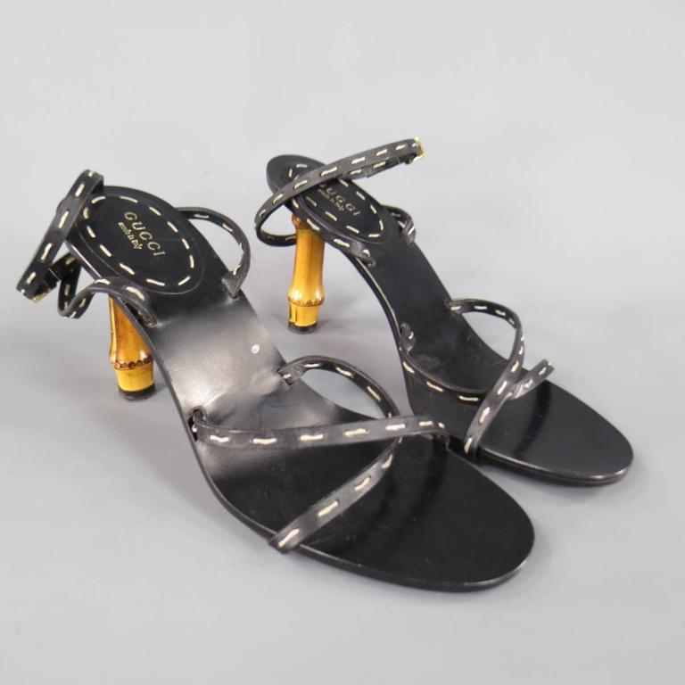 These fabulous GUCCI sandals feature thin black leather cross straps with contrast stitching and a thick bamboo heel. With Box. Made in Italy.