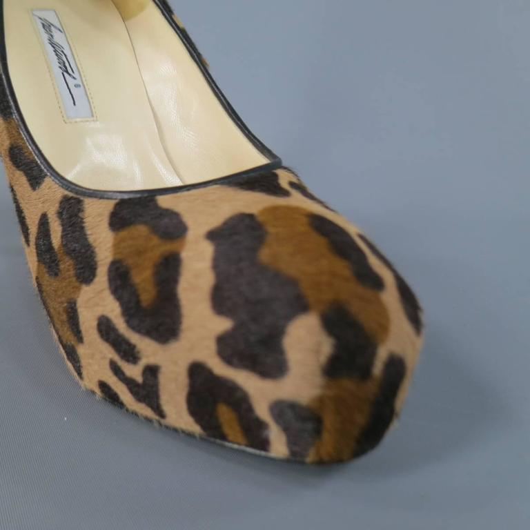 These fabulous BIAN ATWOOD pumps come in beige and brown leaoprad cheetah print pony hair leather and feature a concealed platform black piping and gorgeous silver tone chain detail down the heel. Made in Italy.