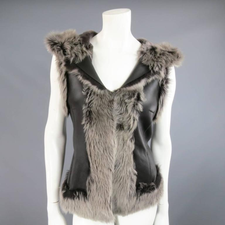 Gorgeous ROSENBERG & LENHART winter vest in black leather lamb shearling with gray fur featuring hook eye closures, side pockets, and a hood. Made in Germany.