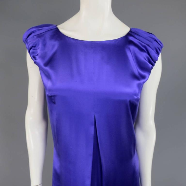 This gorgeous DOLCE & GABBANA cocktail dress comes in a purple silk satin and features an A line silhouette, pleated front, scoop neck, short gathered puff sleeves, and back zip closure. Small imperfection in detail shot. Made in Italy.   Good