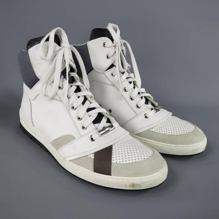 c19c6cae682e2 DIOR HOMME white smooth leather high top sneakers featuring a perforated  toe box with brown ribbon