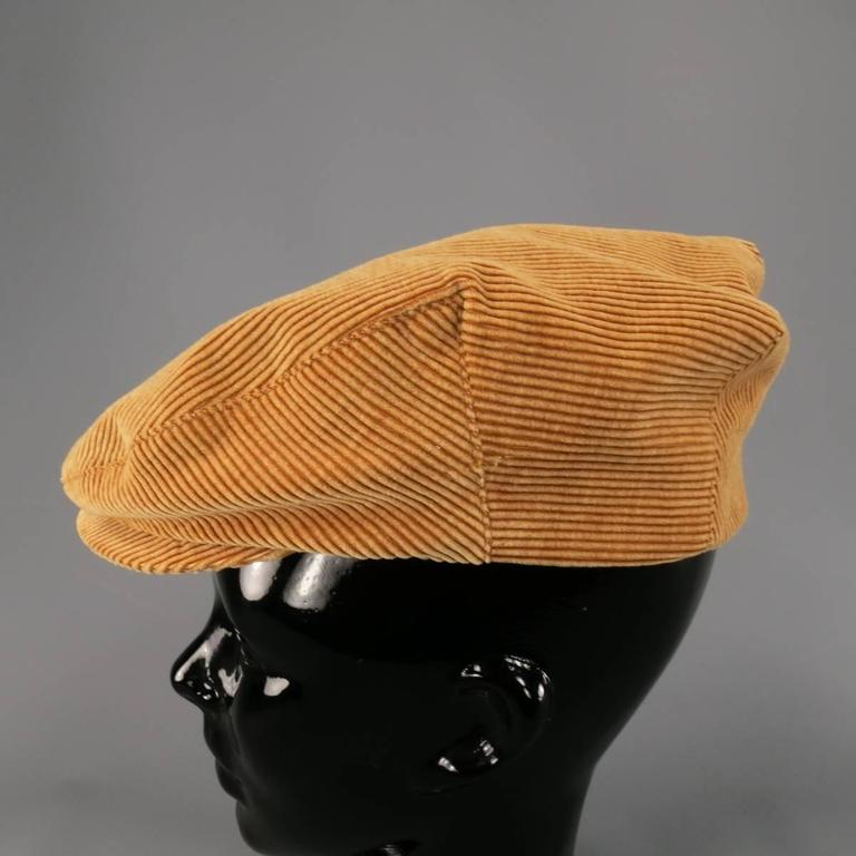 Vintage CHANEL page boy's cap in thick tan corduroy with short brim and black CC lining. Made in France.